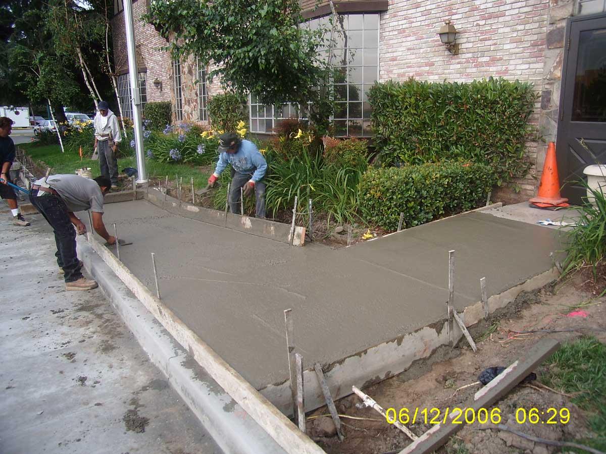 Sidewalk repair installation concrete contractors for Removing concrete walkway